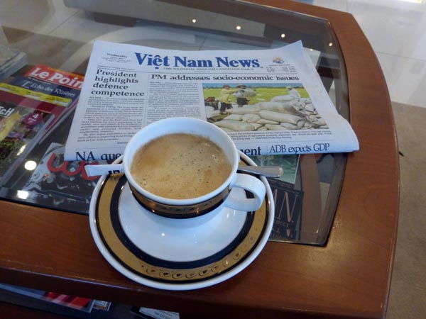 Complimentary cappuccino and English newspaper